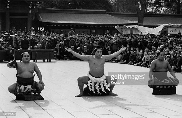 Sumo Grand Champion Taiho performing the ritual of Dohyoiri at Meiji Shinto shrine in Tokyo at an annual ceremony of homage Left to right Wakahichibu...