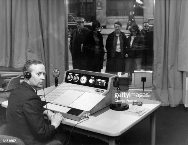 BBC weather reader Michael Garrod at his desk in the new meteorological office which can be viewed by people on the street