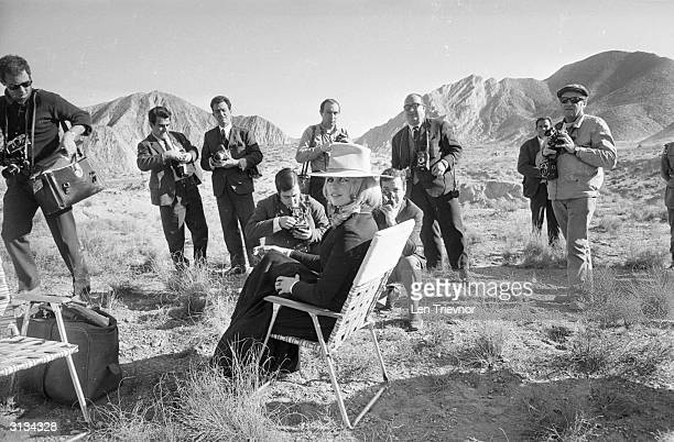 French screen goddess Brigitte Bardot surrounded by photographers on the set of her latest film the Edward Dmytryk western 'Shalako'