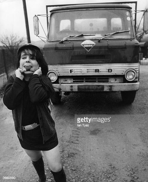 Strongwoman Maria McArd pulling a 12ton lorry with her teeth