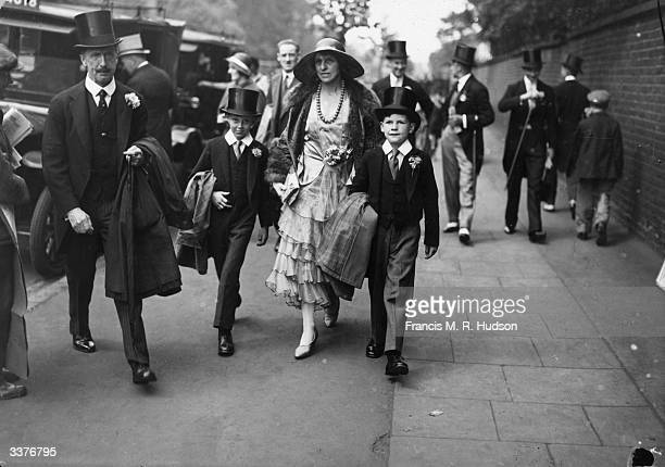 Mrs Vernon Royal and her twin sons pupils at Eton College arriving for the annual Eton v Harrow match at Lord's cricket ground London