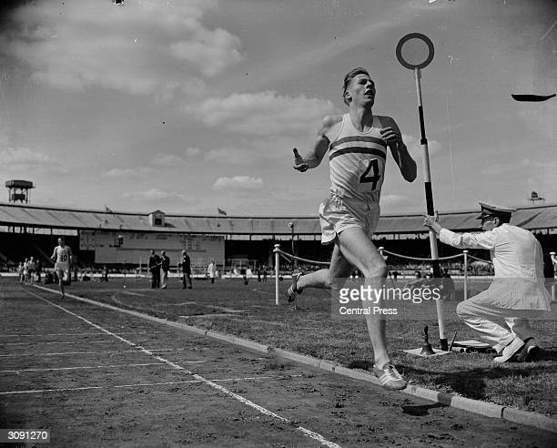 British middledistance runner Roger Bannister comfortably winning the one mile race in record time during the AAA Championships at White City Stadium