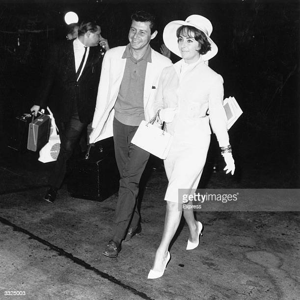 Actress Elizabeth Taylor with her fourth husband Eddie Fisher at Heathrow Airport London
