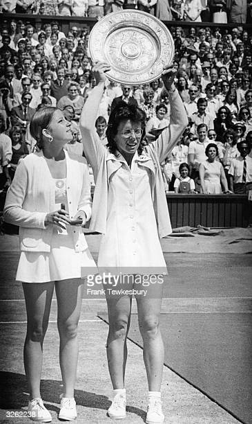 Billie Jean King of the USA holds up the women's singles trophy on the Centre Court at Wimbledon for the fifth time as her beaten opponent Chris...