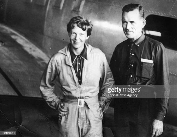 American aviatrix Amelia Earhart with her navigator Captain Fred Noonan in the hangar at Parnamerim airfield Natal Brazil 11th June 1937 Together...