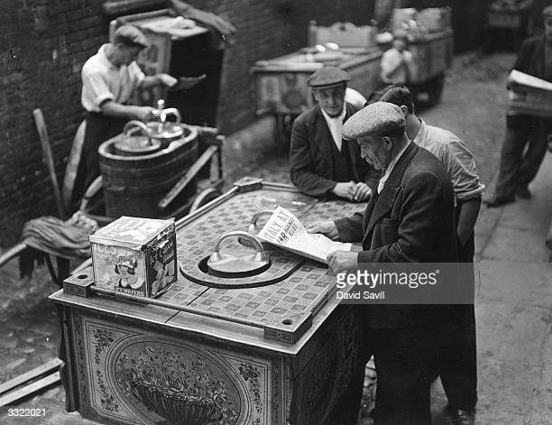 An Italian icecream vendor Mr Guilliotti reads the news that Italy has declared war on the Allies His two sons are with the British Expeditionary...