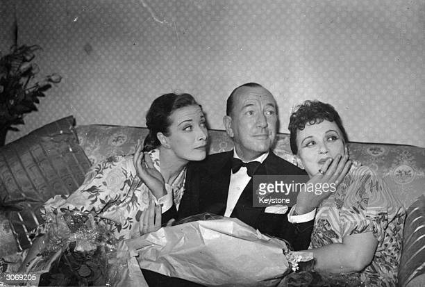 English playwright actor producer and composer Noel Coward with British actress Vanessa Lee and American actress Mary Ellis after the first night of...