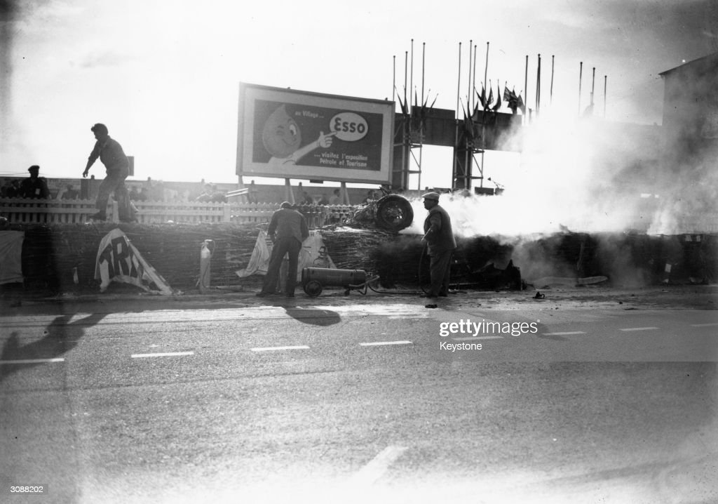 Smoke conceals Pierre Levegh's Mercedes which crashed into the crowd at the Le Mans 24 hour race killing 80 people including the driver and injuring...