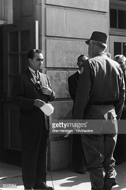 Segregationist Alabama Governor George C Wallace blocks the doorway to the University of Alabama while listening to Brigadier General Henry Graham of...