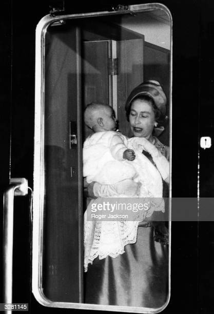 Queen Elizabeth II holding Prince Edward on their way to Balmoral Castle in Scotland