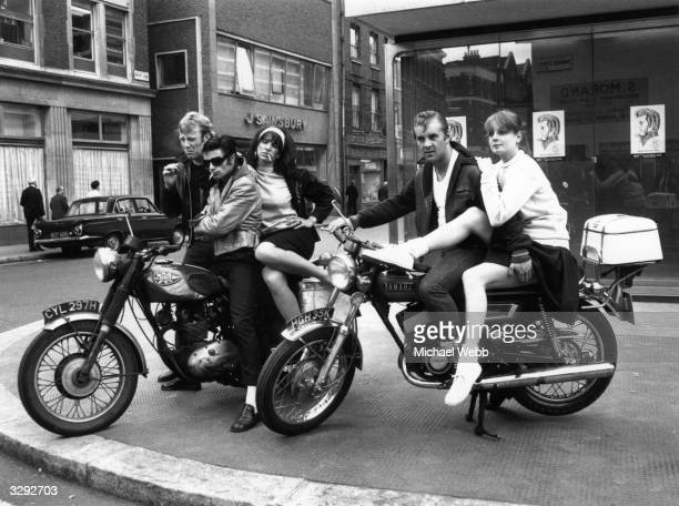 Five members of the cast of Rock 'n' Roll musical 'Grease' arrive at the New London Theatre Drury Lane on motorcycles From left to right they are...
