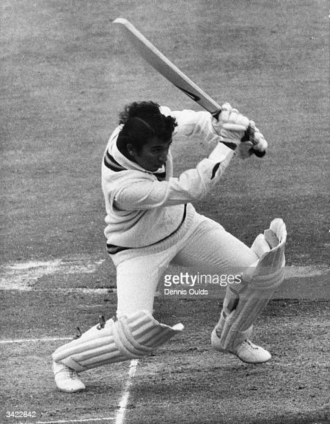 Indian cricket batsman Sunil Gavaskar drives Hendrick to the boundary during the last day of play between England and India at Old Trafford