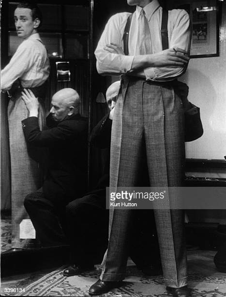 The first part of the suit to be fitted is the trousers A trouser expert at Savile row makes sure the garment drapes straight down the back and front...