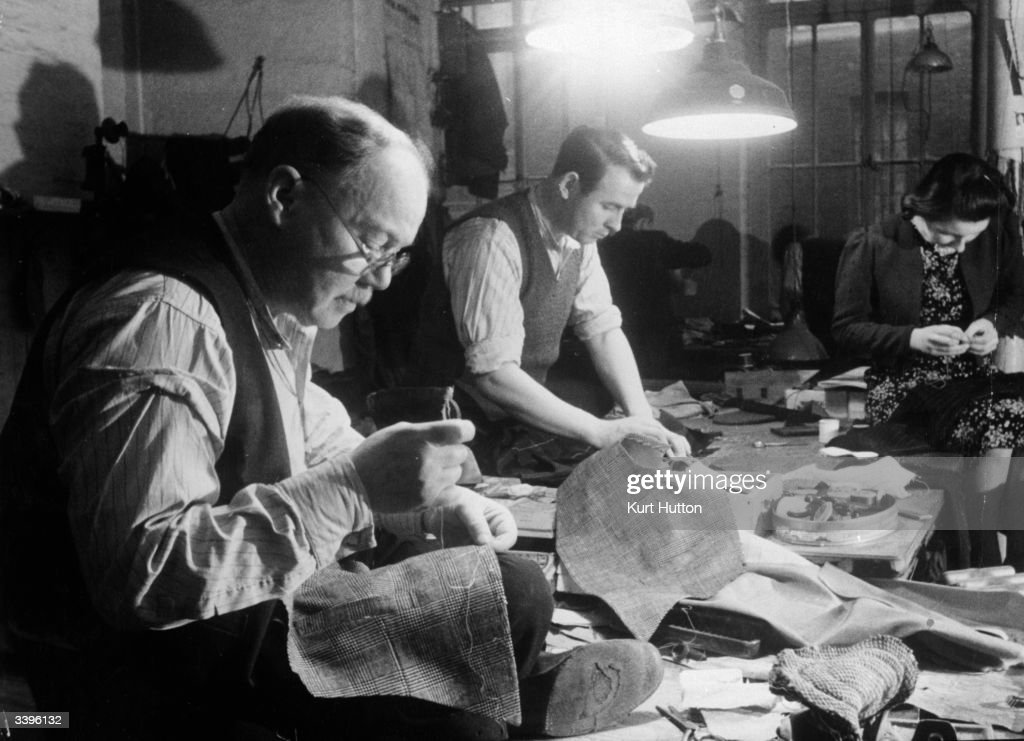 William Stewart has worked with wasitcoats all his life and is paid on a piece rate basis set by the Association of London Master Tailors. Original Publication: Picture Post - 100 - Making A Savile Row Suit - pub. 1939