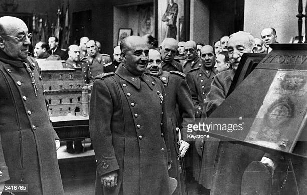Spanish dictator General Franco inaugurates a number of new rooms in the army museum A new exhibit that grabs his attention is a fascist newspaper...