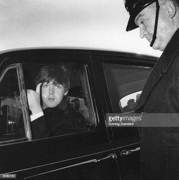 Beatle Paul McCartney arriving at London Airport