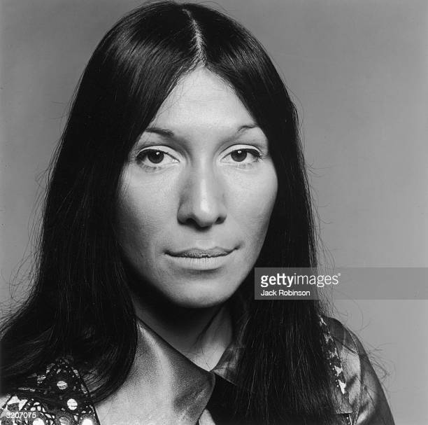 Headshot portrait of Canadian musician Buffy St Marie She wears her long black hair down