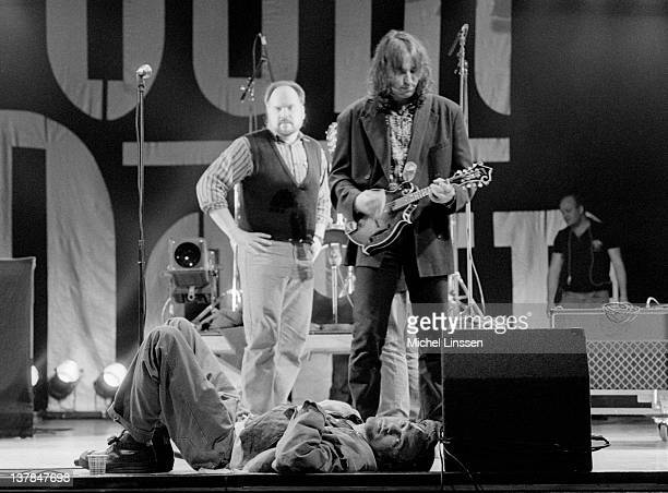 Michael Stipe and guitarist Peter Buck from American band REM perform live on stage in the Netherlands on 11th March 1991