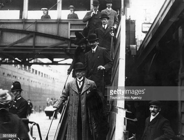 Mr Bruce Ismay a survivor of the 'Titanic' disaster and chairman of the White Star Line coming down the gangway at Customs House Liverpool after...