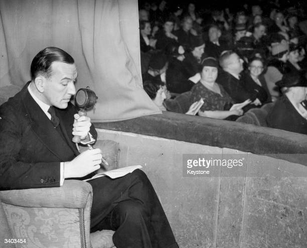 English writer actor and director Noel Coward introduces his own show 'Operette' for the BBC as it broadcast to the nation in the 'Tunes Of The Town'...