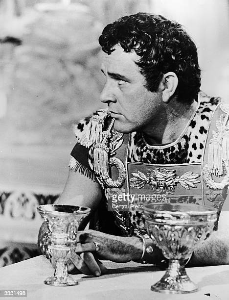 Welsh actor Richard Burton in his role as Mark Antony in the banquet scene from Joseph L Mankiewicz's film 'Cleopatra'