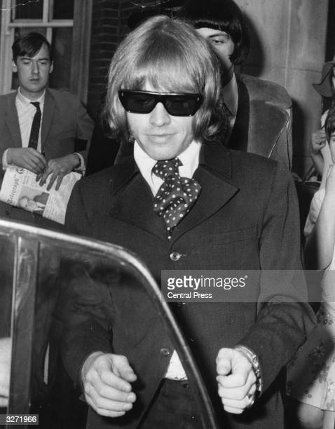 Brian Jones guitarist with British pop group the Rolling Stones leaves West London Magistrates Court after appearing on charges of unlawful...