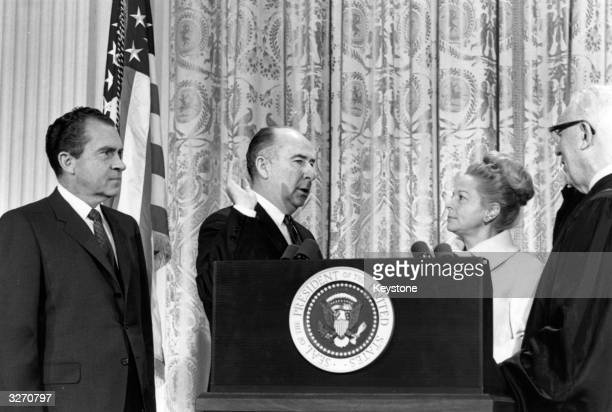 American politician and former attorneygeneral John Mitchell one of Richard Nixon's top aides is sworn in at the Senate He is facing charges in...