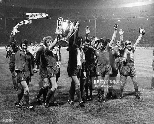 The players of Liverpool Football Club carry the trophy on a lap of honour after their 10 victory over FC Bruges in the European Cup final at Wembley...