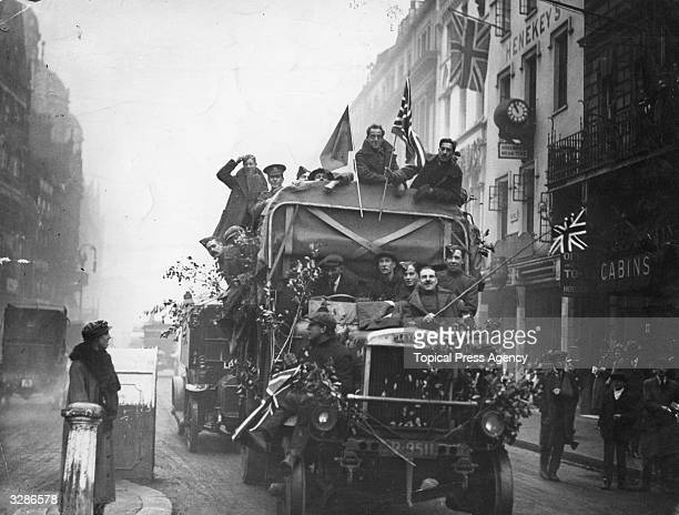 An army lorry in a London street on Armistice Day carrying jubilant passengers