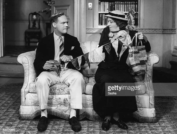 Cyril Raymond as Lord Bucktrout and Margaret Rutherford as Miss Flower in the play 'Short Story' at the Queen's Theatre