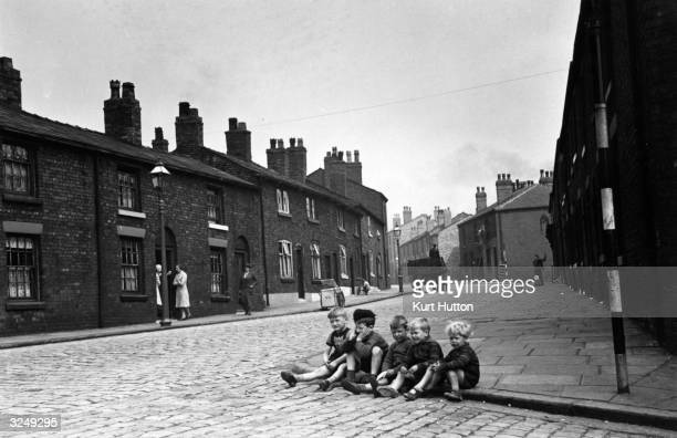 Children playing games on the streets of Wigan in Lancashire Original Publication Picture Post 228 Wigan pub 1939