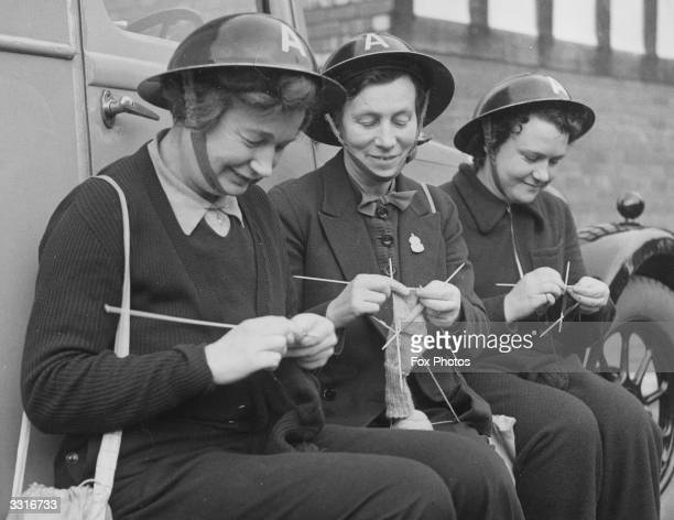 Women ambulancer drivers of the Waterloo and Crosby Ambulance Service knitting socks for soldiers