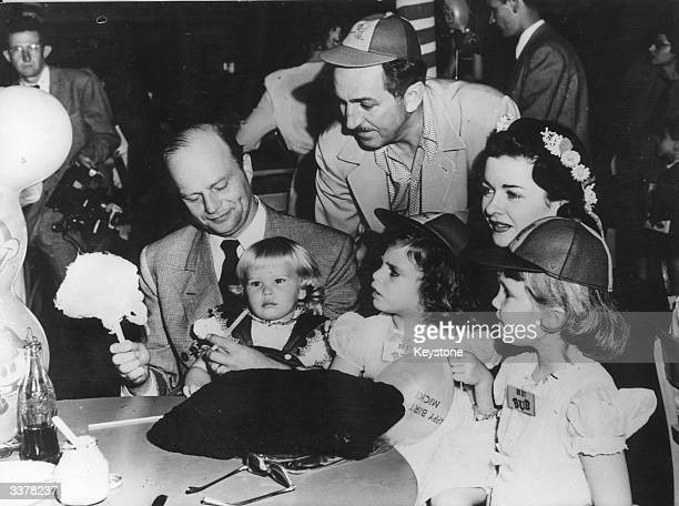 Celebrities young and old gathered at a birthday party for Mickey Mouse at the Disney Studio Left to right Edgar Bergen Candice Bergen Walt Disney...