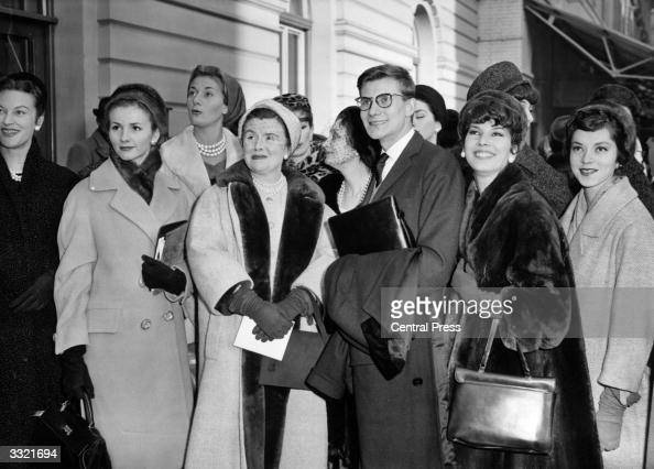 French fashion designer Yves Saint Laurent and a group of fashion models on arrival at Victoria Station London bound for a show of his collection at...