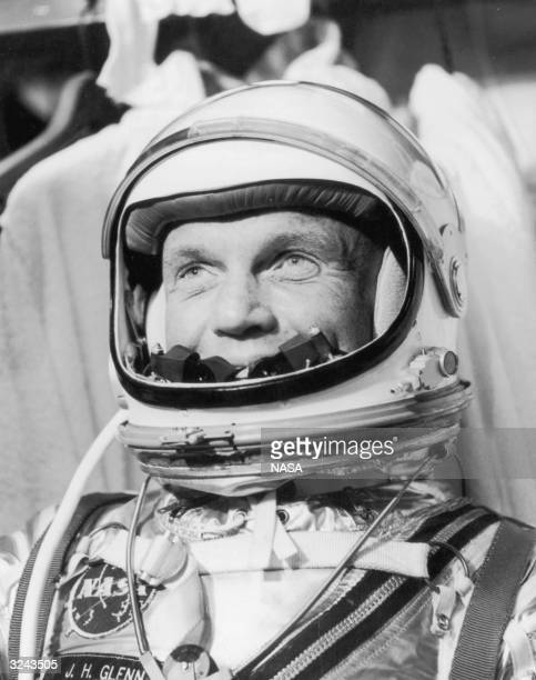 Headshot of American astronaut John Glenn the first American to orbit the earth wearing his space pressure suit and helmet Cape Canaveral Florida