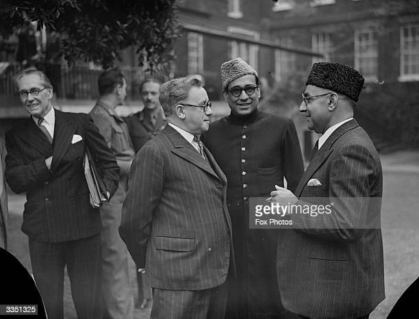 Herbert Morrison Lord President of the Council talking to Mr Rabintoola High Commisioner for Pakistan and Mr Liaquat Ali Khan prime minister of...