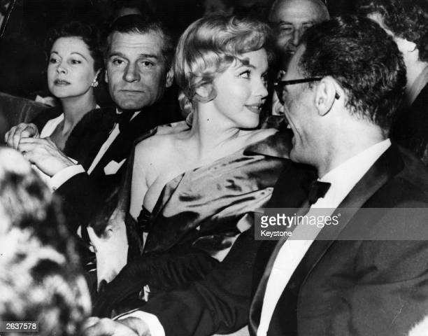 American actress Marilyn Monroe with her husband playwright Arthur Miller at the first night of his play 'A View From The Bridge' with Sir Laurence...