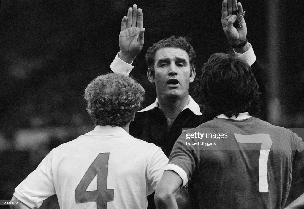 Referee R Matthenson sends off Kevin Keegan from Liverpool FC and Billy Bremner of Leeds United FC for trading punches during a testy Charity Shield...