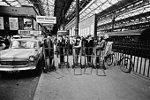 English rock and roll group The Rolling Stones posed with porters' trolleys at Victoria Station in London on 11th October 1964 Left to right Bill...