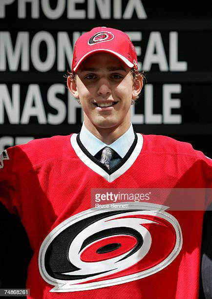 11th overall pick Brandon Sutter of the Carolina Huricanes poses onstage after being drafted in the first round of the 2007 NHL Entry Draft at...