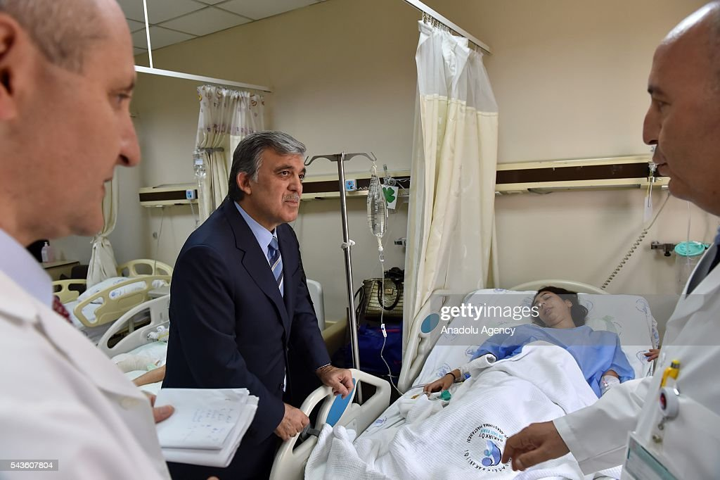11th President of Turkey Abdullah Gul (2nd L) visits the Ataturk International Airport terror attack victims at Bakirkoy Dr. Sadi Konuk Hospital in Istanbul, Turkey on Jun 29, 2016.