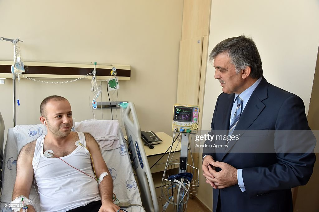 11th President of Turkey Abdullah Gul (R) visits the Ataturk International Airport terror attack victims at Bakirkoy Dr. Sadi Konuk Hospital in Istanbul, Turkey on Jun 29, 2016.
