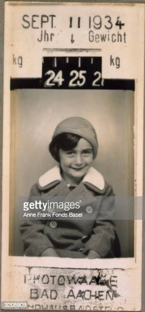 EXCLUSIVE A portrait of Anne Frank taken in a photography booth with her weight and the date the photo was taken printed on the border Aachen Germany...