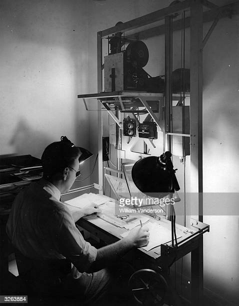 Cartoonist Anson Dyer hailed as Britain's answer to Walt Disney is at work on an animated cartoon of Stanley Holloway's 'Sam' showing how the...
