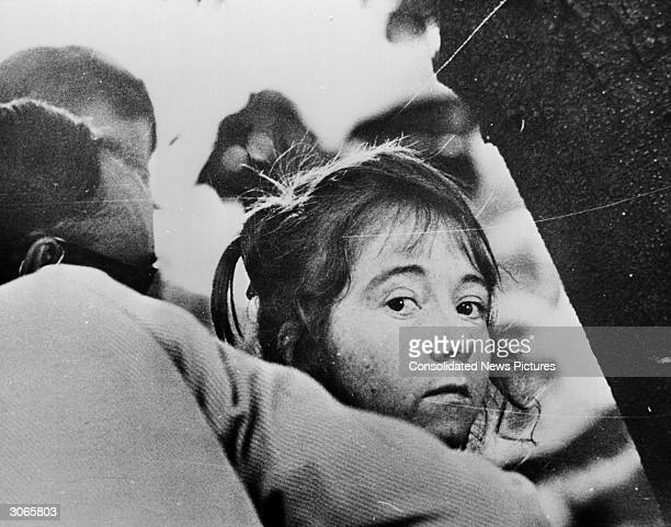 Lynette Fromme aka Squeaky an acolyte of Charles Manson being led away after her failed attempt to kill President Ford