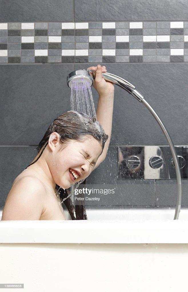 11-year old girl washing hair