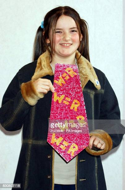 11yearold Amber Storm Clark from Newark in Nottinghamshire with her winning design during a photocall for the Guild of British Tie Makers Young Tie...