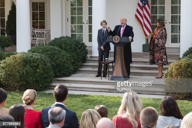 11yearold Barron Trump and his Mom First Lady Melania Trump stand next to President Donald Trump as he speaks at the National Thanksgiving Turkey...