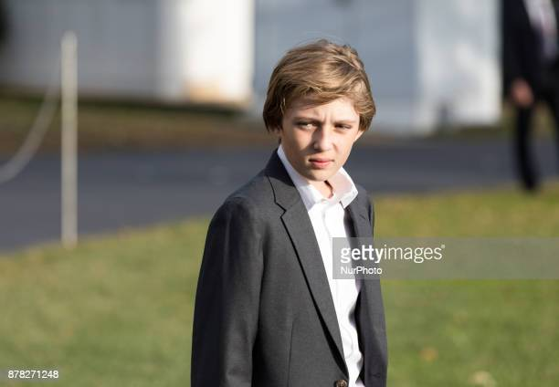 11yearold Barron Trump waits for his Dad President Donald Trump as he speaks to reporters before their departure for the Thanksgiving Holiday from...