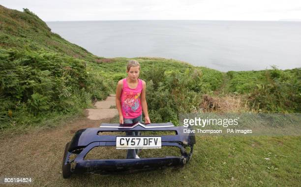 11yearold Paige Dean shown holding a piece of the car which came off before entering the sea who cheated death after jumping from her grandfather's...